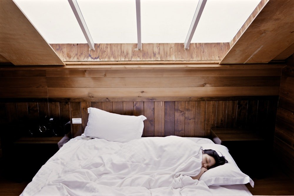woman sleeping in a bed
